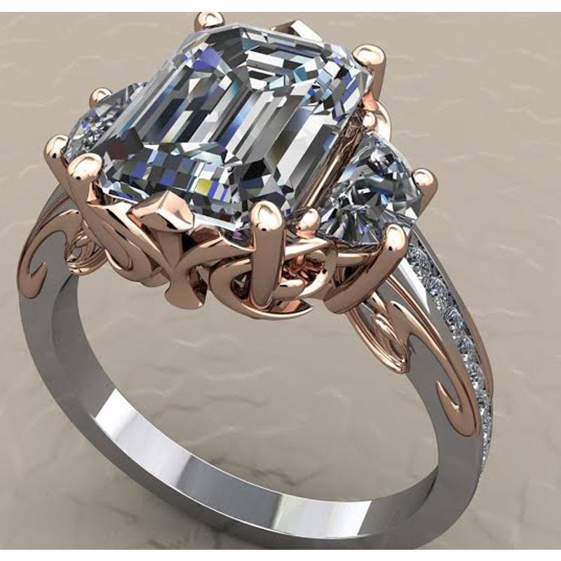 Emerald diamond ring set in14 karat rose and white gold.